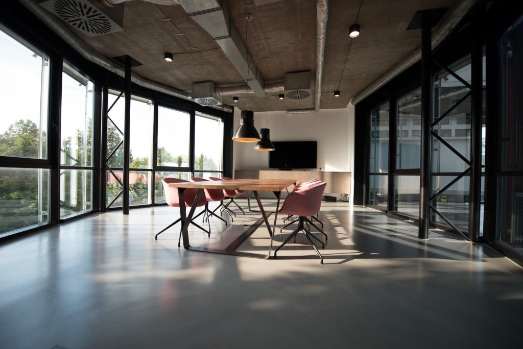 An empty office space with a table and chairs