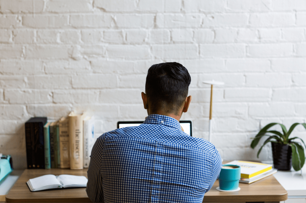 Man sat at a desk working from home
