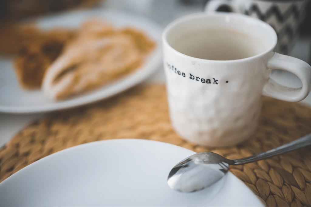 """A coffee cup with the words """"coffee break"""" embossed on the side"""
