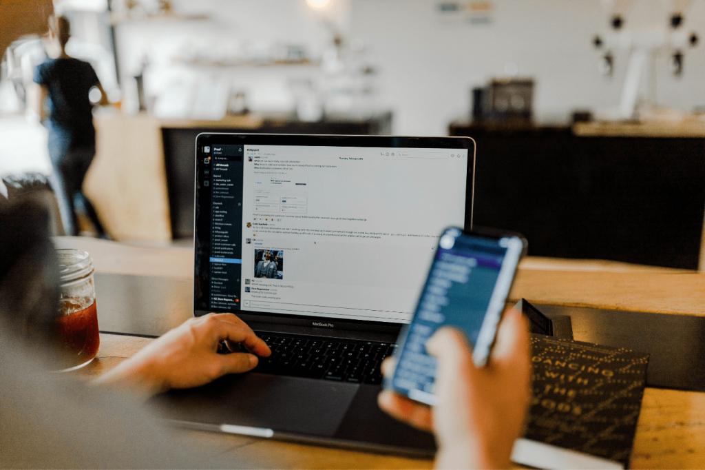 A laptop open on the communication platform, Slack