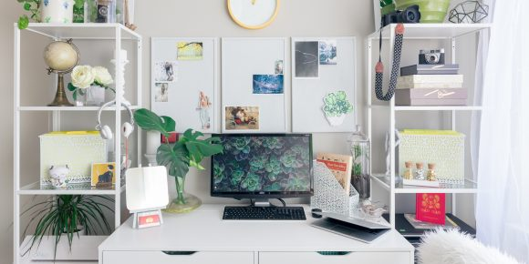 a green home office with plants